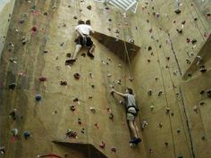 A rock climbing wall is a manufactured wall that can be found in gyms and amusement/theme parks. Description from saidaonline.com. I searched for this on bing.com/images