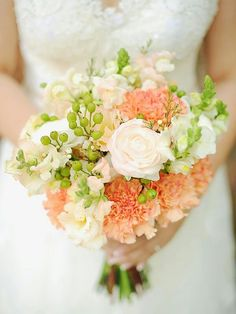 {Lovely Bouquet Comprised Of: Peach Carnations, Blush & White Sweet Peas, White Ranunculus, & Green Hypericum································}