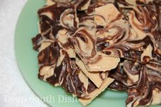 One of the easiest candies to make, this Tiger Butter Bark is made using almond bark candy coating mixed with peanut butter, topped with chopped peanuts and melted semi-sweet chocolate chips.