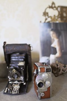 Camera = I LOVE old cameras. I have a bunch of them all over my bookcases in my den. Many of them once belonged to my Darling Daddy, so they have special meaning to me as well as appealing to me aesthetically. 8-)