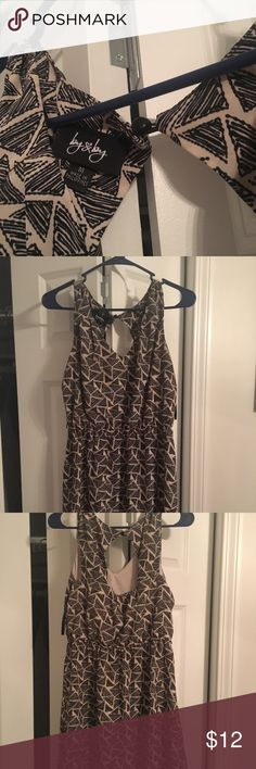 Black and Tan dress Size medium black and tan dress. Soft silky material. Very comfortable. Worn twice. Open at the top of the back as shown in pics by&by Dresses