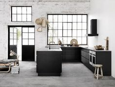 i like the Black kitchen and the wall with the faded paint