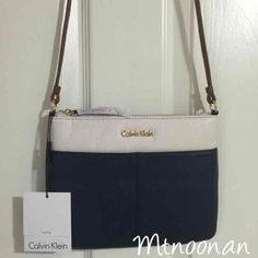 I just listed Calvin Klein Genuine Leather ColorBlock Crossbody Purse… ($78) on Mercari! Come check it out!