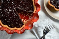 This is a chocolate chess pie — filled with white sugar, evaporated milk, and cocoa powder — adapted to local honey, fresh cream, dark cocoa powder and sea salt from the nearby Bull's Bay Saltworks. (Photo: Karsten Moran for The New York Times)