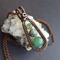 Wire Moon Jewelry is on Tumbr! Wire wrapped copper necklace with green stones. Hand made wire weave jewelry.