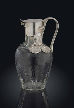 A SILVER-MOUNTED GLASS DECANTER MARKED K. FABERGÉ WITH THE IMPERIAL WARRANT, MOSCOW, 1895