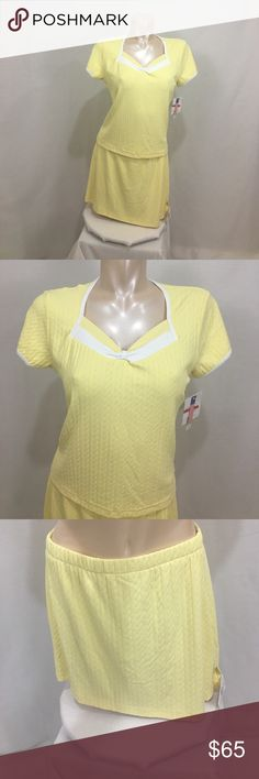 Wimbledon yellow cable tennis skort/top set Gorgeous yellow color with a cable knit pattern. Materials is nylon/spandex. Size large. Lots of stretch. Measurements are approx in inches laying flat. SKORT- (skirt)  w-14.5 length-14.5 (short) h-15 inseam-4 rise- 8 has upside down pocket. TOP- b-19 length-22  🌹no trades 🌹discounts on bundles of 2+  🌹1000 items listed, take a peak!  🌹suggested user, posh compliant:) Wimbledon Skirts Skirt Sets