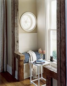 I love everything about this stylish nook. Textures, palette, wood beams and round window. I'd curl up here with a coffee and book all day.