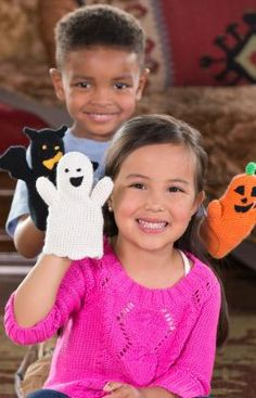 Halloween Puppets made with Red Heart Reflective Yarn would steal the show at a campfire ghost story!