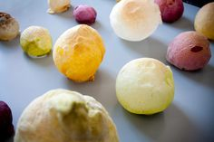 Coloured dough blown into a set of edible balloons filled with odours.