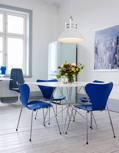 Dining room | white and blue Arne Jacobsen chairs