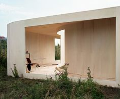 Dutch architect Anne Holtrop has completed a pavilion in an overgrown field in Almere, Netherlands, with plans that follow existing trails and paths across the site. Called Trail House, the structure begins as an extension of the paths and features the same curvature of the trails, getting wider at certain parts and dividing in other