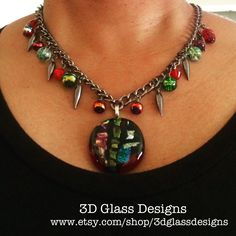 Sassy and fun necklace featuring a dichroic glass pendant on a gunmetal colored chain with beaded dangles.