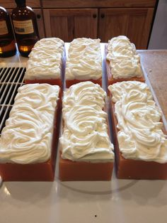Loaves of handmade, cold-process soap scented with Spiced Apple Cider fragrance and decorated with a dollop of 'whipped cream' on top (the whipped cream is soap too!).   #handmade #soap