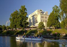 A sightseeing boat  passing Gothenburg's Grand Theatre, Gothenburg, Sweden