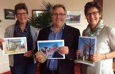 De winnaars van de gemeentegids-fotowedstrijd (Jac Nooijens, Ingrid Prins en J. van Poppel-Huijbregts) ontvingen op 23 juni hun kadobonnen van burgemeester Heleen van Rijnbach-De Groot.