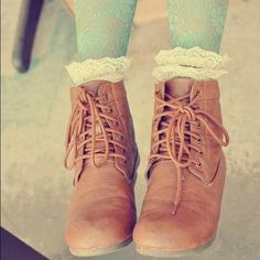 Great look for teen girls! Tan boots and funky aqua lace tights.