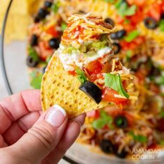 Taco seasoned refried beans, guacamole, sour cream, salsa, Mexican cheese, tomatoes, olives, and a topping of chopped cilantro bump this dish right into one of our favorite appetizer categories. 7 layer dip is by far the best party appetizer for football games, potlucks, and get-togethers loaded with all the best taco-inspired fixings everyone will enjoy! The name says it all, 7 layers of deliciousness all in one party dip. Taco seasoned refried beans, guacamole, sour cream, salsa, Mexican chees