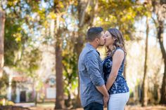 Engagement kiss in a park Photo By Eternal Light Photography