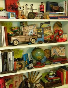When you have a wonderful collection of vintage toys like this, show them all together. Collections look better grouped. Great personality here, as well as display. Vintage Love, Vintage Decor, Vintage Antiques, Vintage Items, Vintage Display, Vintage Interiors, Vintage Books, Vintage Posters, Interior Design Minimalist