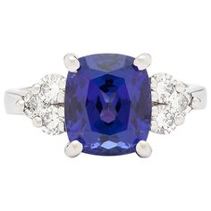 4.14 Carat Cushion-Cut Tanzanite Diamond Platinum Ring | From a unique collection of vintage cocktail rings at https://www.1stdibs.com/jewelry/rings/cocktail-rings/