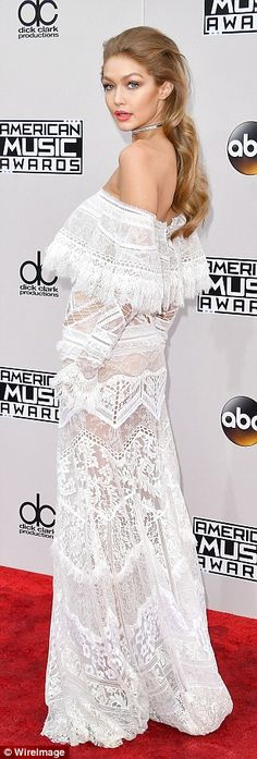 Red carpet pro: Gigi's Roberto Cavalli dress was made of sheer lace with a ruffled off-the-shoulder neckline