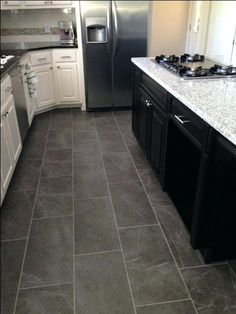 I also enjoy a mid-tone gray floor with the white cabinet/black countertop combo. However, I am hesitant to add gray to the house's color palette.  Note the subway tile (without black grout) and the hardware is silver (I'm leaning towards black)