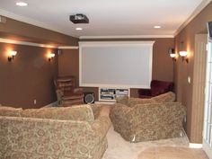 basement   Custom framed 4ftx 8ft screen for Projection TV system. Wall sconce ... (wall color, trim, with projector screen)