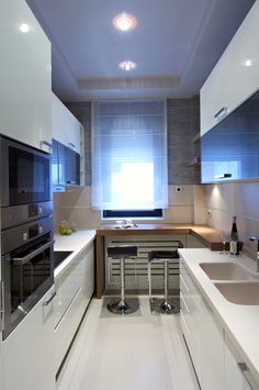 Stylish small modern kitchen with eat-in counter. Cabinets and floor in white with small black appliances. for white kitchen interior design 50 Small Kitchen Ideas (Don't Overthink Compact Design) Small Modern Kitchens, Small Galley Kitchens, Black Kitchens, Kitchen Modern, Interior Design Boards, Interior Design Kitchen, Home Design Decor, Design Ideas, Kitchen Designs