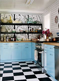 """Love the """"branch"""" backdrop for the Robin's Egg Blue cabinets"""