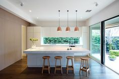 A luxurious interior refurbishment of a Victorian cottage to reveal a functional series of spaces and garden connections. Kitchen Island Bench, Kitchen Benches, Kitchen Island Overhang, Kitchen Living, New Kitchen, Kitchen With Window, Kitchen Wood, Kitchen Interior, Kitchen Decor
