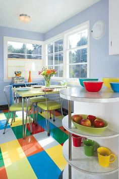 The owner of a 1947 mid-century cottage painted (and then varnished) her worn battleship-gray linoleum in a patchwork of greens, yellows, corals, and turquoise. It's a look that can be replicated in new, custom-cut linoleum. Kitchen Floor Lino, Linoleum Kitchen Floors, Modern Kitchen Tiles, Mid Century Modern Kitchen, Linoleum Flooring, Dark Flooring, Brick Flooring, Basement Flooring, Rubber Flooring