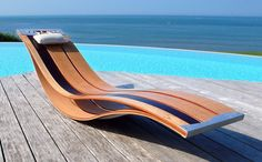 hese elegant lounge chairs from Pooz are made for outdoor living and lounging. Inspired by the natural flex and features of wood, the easy-going, undulating shapes make these lounge chairs the perfect complement at poolside, on the deck or in the garden.  Would love to have:-))