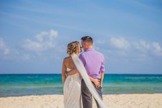 Destination beach wedding at Riu Yucatan in Playa Del Carmen, Mexico / Ashley & Chris Real Wedding - WeddingVacations.com