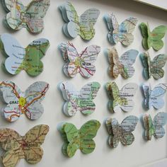 Butterfly map cut outs added together for the places you've traveled and framed.