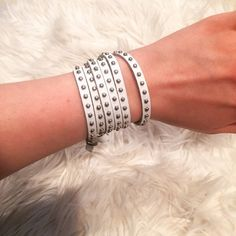 studded leather wrap bracelet ♠️ White leather adjustable wrap bracelet! Silver studs adorn the bracelet, inner leather is a soft gray color. The bracelet is in new condition and the clasp is similar to a belt buckle so it's easy to adjust the size of the bracelet. Jewelry Bracelets
