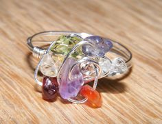 This stunning Chakra Twist Silver Ring (Reiki Infused), up for auctions now - $10 starting bid.