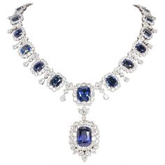 For Sale on 1stdibs - 75.50 carats of beautiful cushion cut Ceylon sapphire's. 17.48 carat cushion cut drop with GIA certificate. 45.13 carats of diamonds, all…