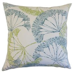 Perfect tossed on your bed or paired with a vase of blooms in the living room, this cotton pillow featuring a floral design in aqua and green.