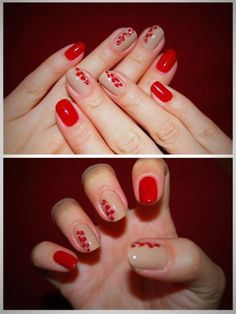 Uñas de color rojo con diseños de pétalos de flores en color rojo