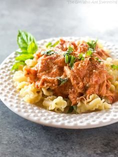 Creamy Tomato Basil Chicken - made in the slow cooker and served over pasta for an easy weeknight dinner. the-girl-who-ate-everything.com