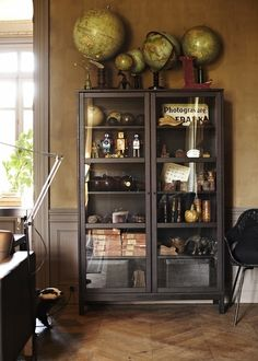 Lovely vintage display cabinet & globe collection. (magnoliajones:  Interior styling by Hans Blomquist)