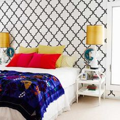Wall Stencil, white side tables, white lamps and bedding, blue throw or quilt