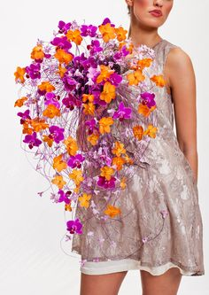 Wonderfully dramatic, contemporary cascading bridal bouquet with gorgeous orange…
