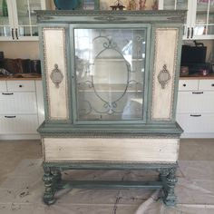 #ourjunkyourtrunk #breakthechalkhabit #rethunkjunk Painted this antique China cabinet in rethunk junk paint by Laura in seaside with cotton accents and dark glaze over everything.