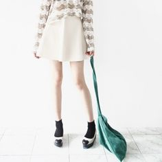 [Flare Leather Skirt] A midi-length faux leather skater skirt featuring a cutted hemline. Side zipper and button closure. Can be worn with stockings or tights in winter.