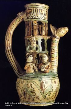 Exeter puzzle jug - The Exeter puzzle jug is one of the most extraordinary pieces of medieval ceramics to have been discovered in northern Europe. The design shows two bishops at the top, young ladies and musicians. The scene points fun at the morals of the medieval clergy. - Royal Albert Memorial Museum & Art Gallery, Exeter