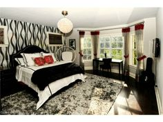 Contemporary bedroom - black and white ribbon wall paper, chandelier.  Pine Ridge Estates in North Naples, Florida
