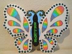 "Wooden Rainbow Butterfly Wall Hanging ~ This beautiful rainbow butterfly is made of white pine heartwood and painted in bright and sparkling colors. It has a rainbow tie dye effect in the wings and the word ""BELIEVE"" on the body. Done in my signature Loco Folko stye, it will brighten any room it hangs in. It measures 14""x11"" and has a sturdy hanger on the back. --- via Ant Farm Studio http://www.artfire.com/ext/shop/product_view/4551453"
