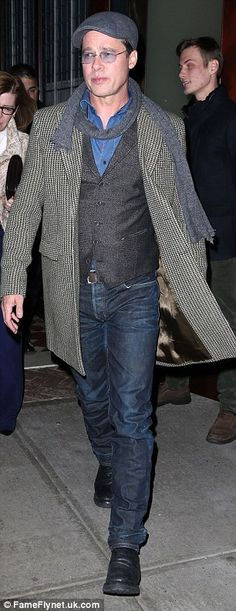 Just call him Mr Jolie! Rocking a grown up version of the on-trend double denim look, he wore dark indigo jeans with a lighter blue shirt